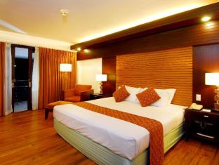 Waterfront Airport Hotel and Casino Mactan Cebu - Hotellihuone