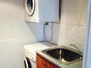 Swan Riverside Luxury Apartment Perth - laundry room with washer and dryer