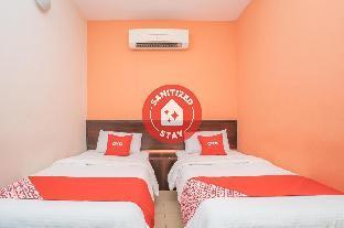 Get Promos OYO 44078 The Island Hotel