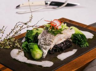 Hotel Muse Bangkok Bangkok - Poached sea bass in coconut cream