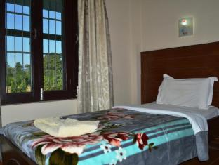 Chitwan Village Resort Chitwan - غرفة الضيوف