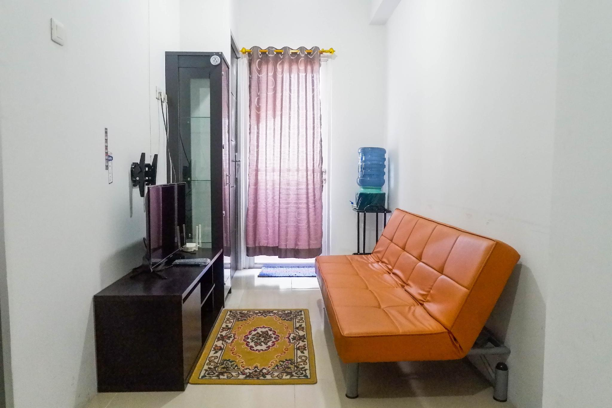 Modern 1BR Apartment At Menara Rungkut By Travelio