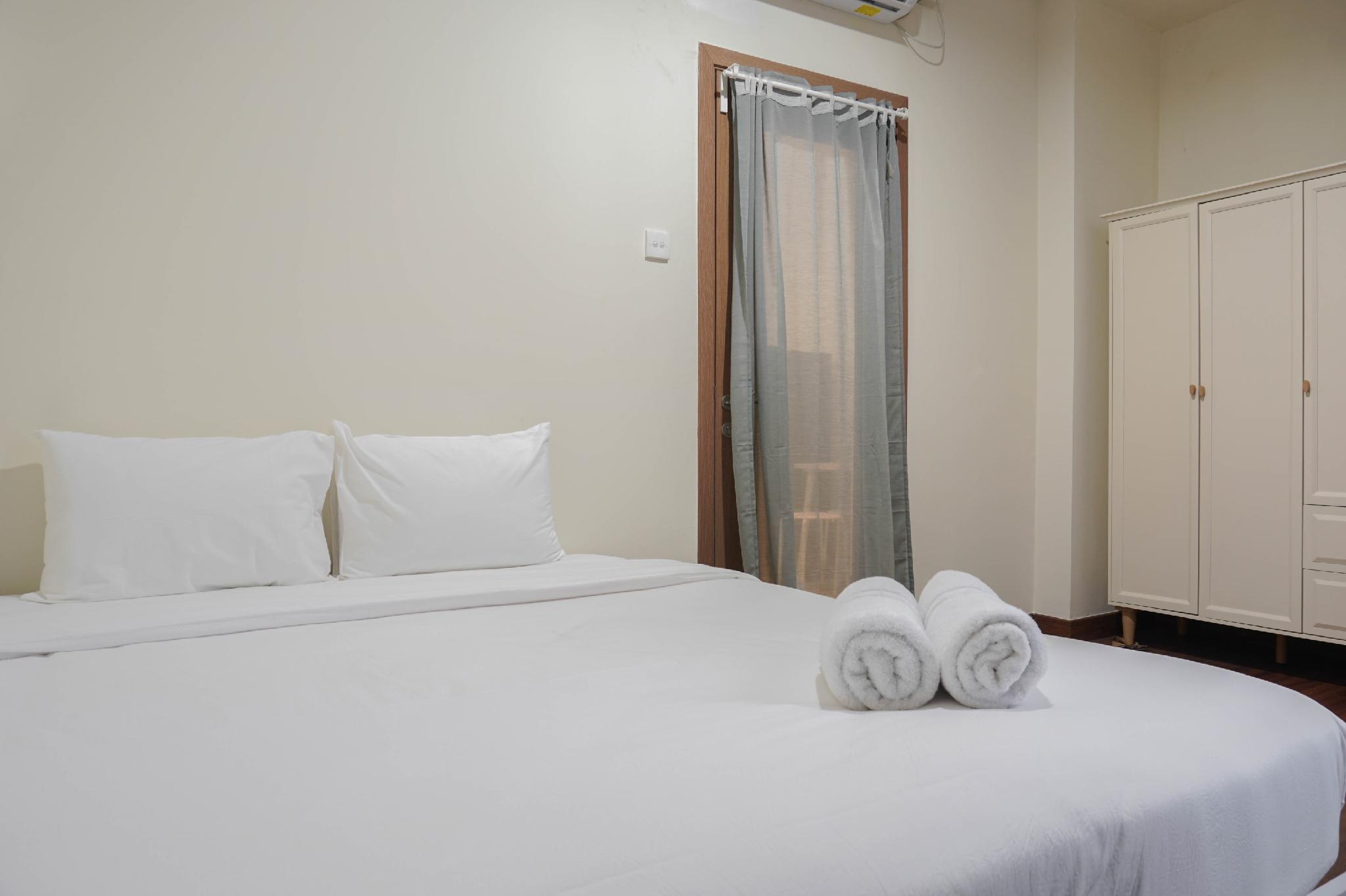 Minimalist 1BR Apartment @Puri Orchard By Travelio