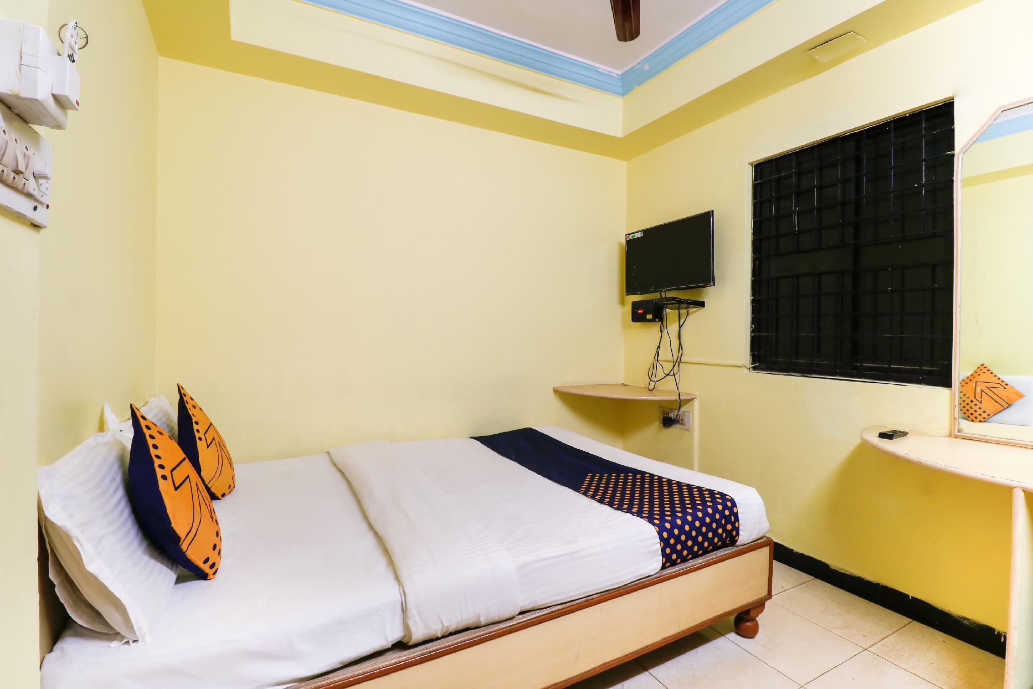 SPOT ON 64221 Krishna Comforts Lodge