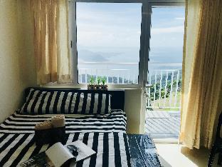 Фото отеля GFam Crib Tagaytay Wind Residences TAAL Lake View