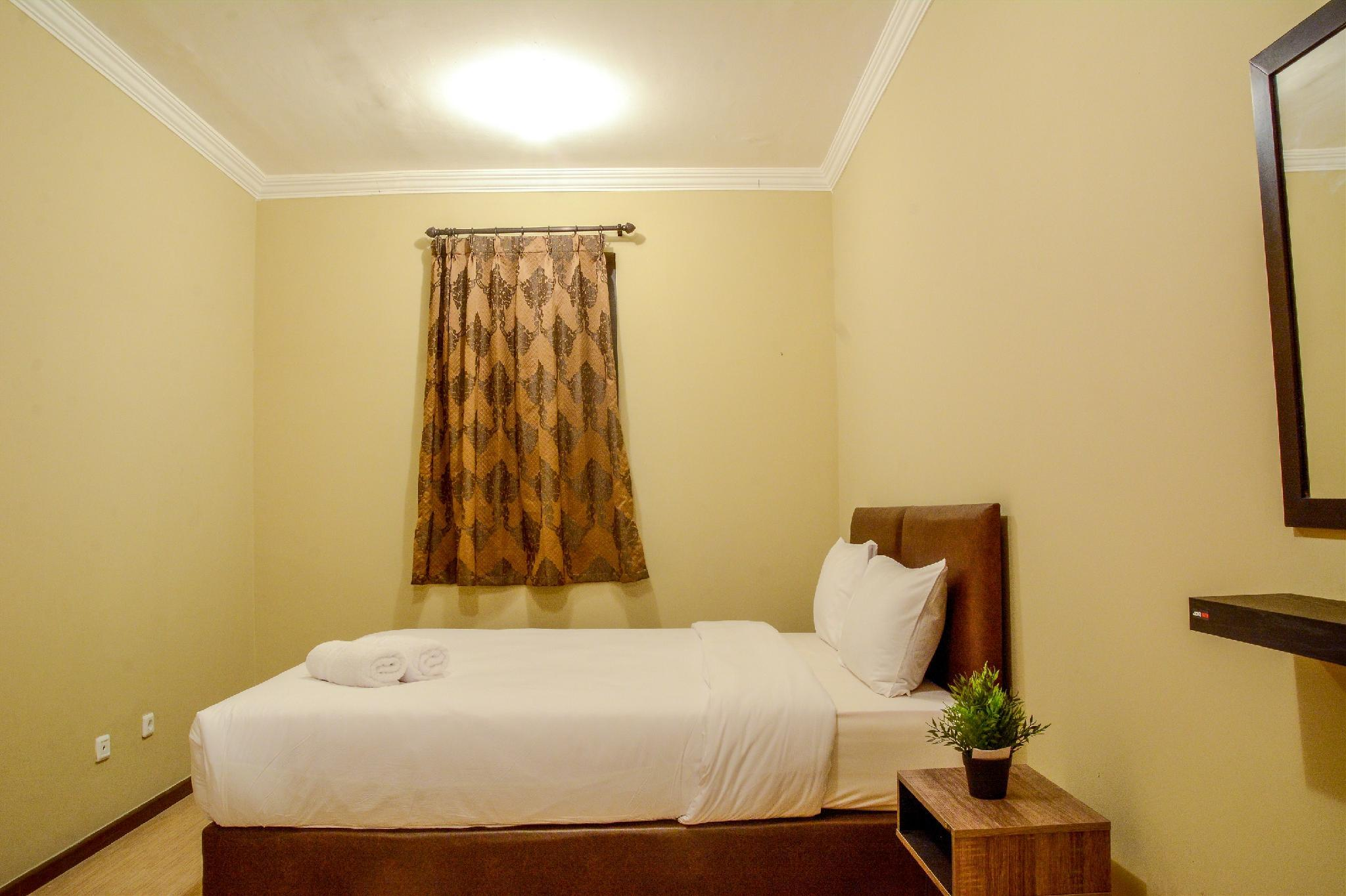 Comfortable 2BR Grand Palace Apartment By Travelio
