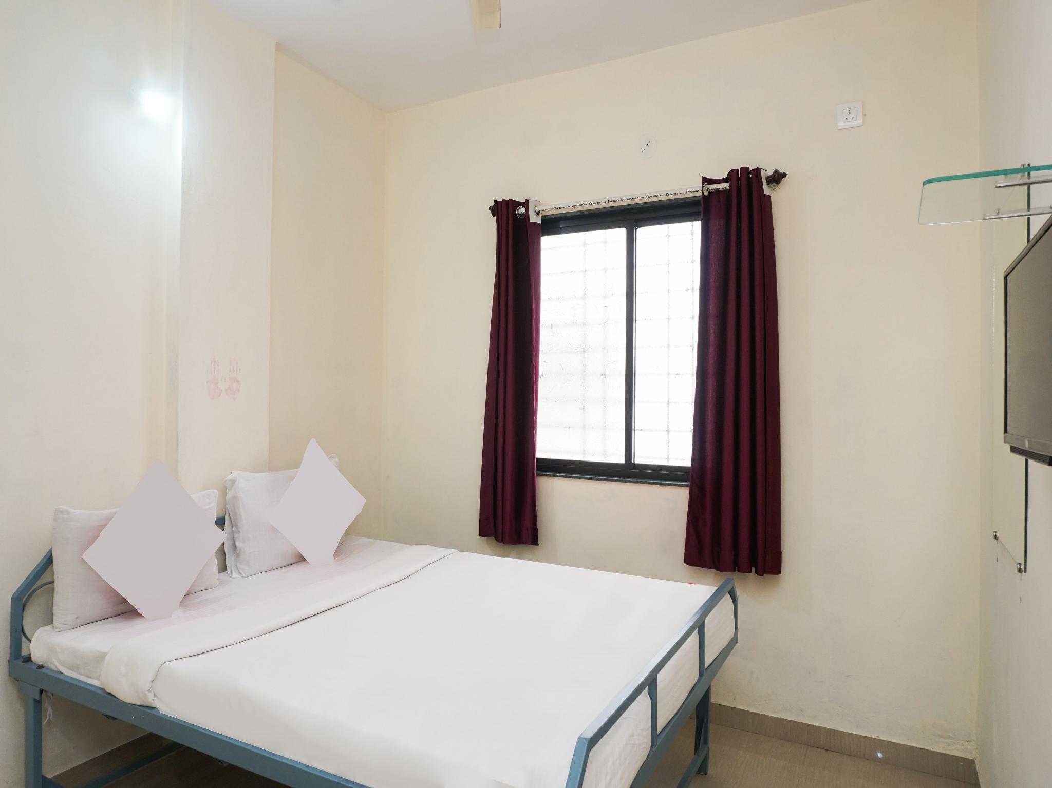 SPOT ON 37095 Sai Sidhi Lodge