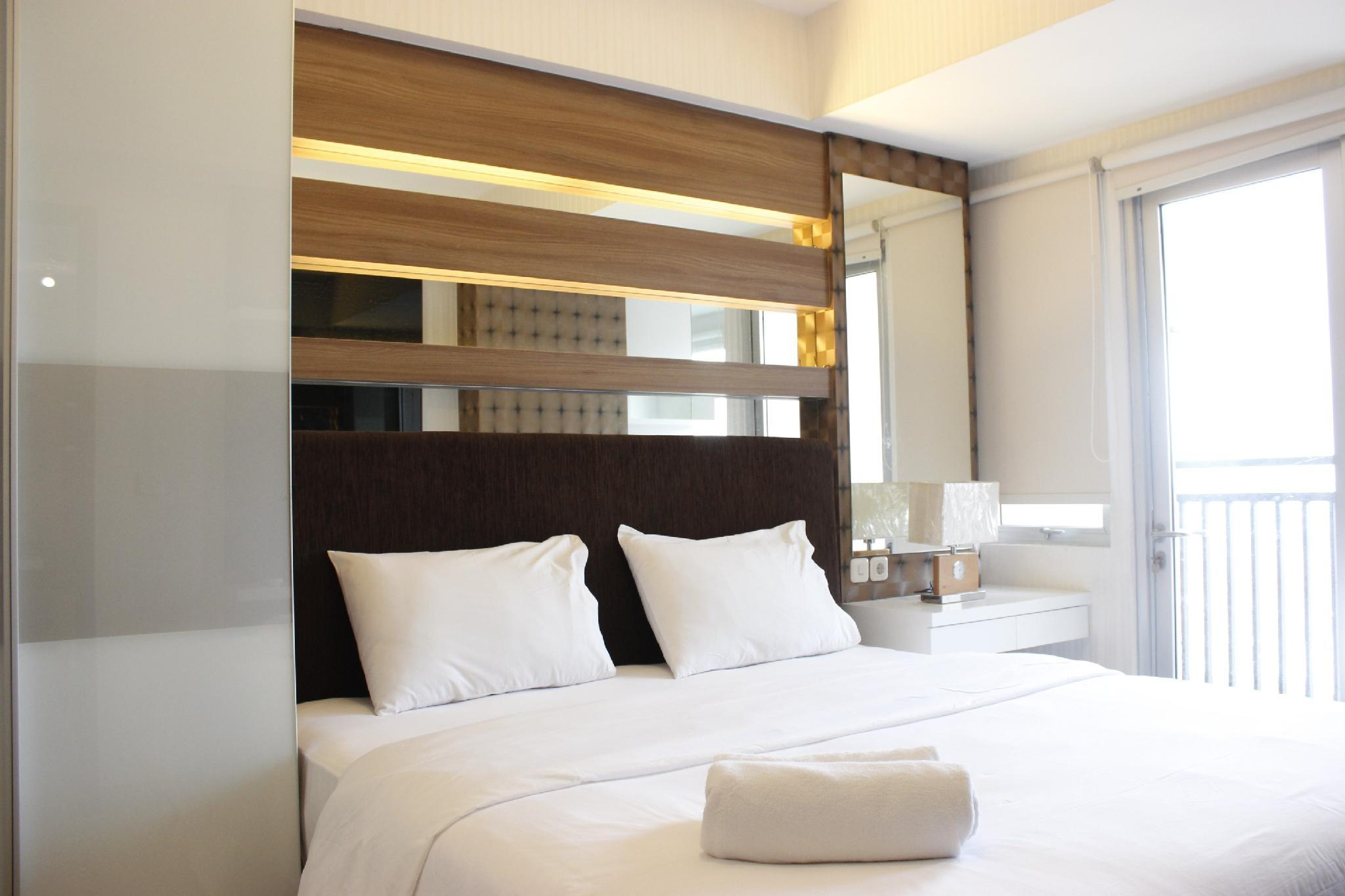 Homey 2BR Apartment At Sudirman Suite By Travelio