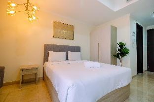 Фото отеля Stylish Studio Room Menteng Park Apartment By Travelio