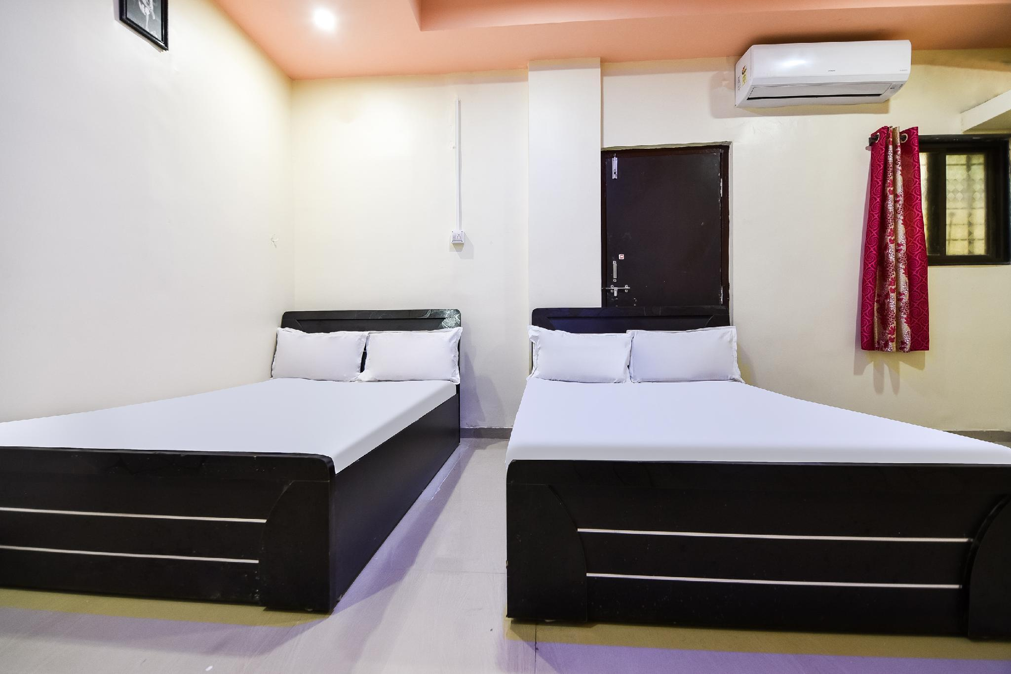 SPOT ON 46999 Hotel Sai Satya