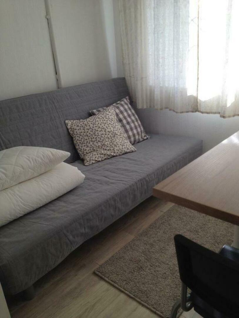 Small Room With A Folding Sofa