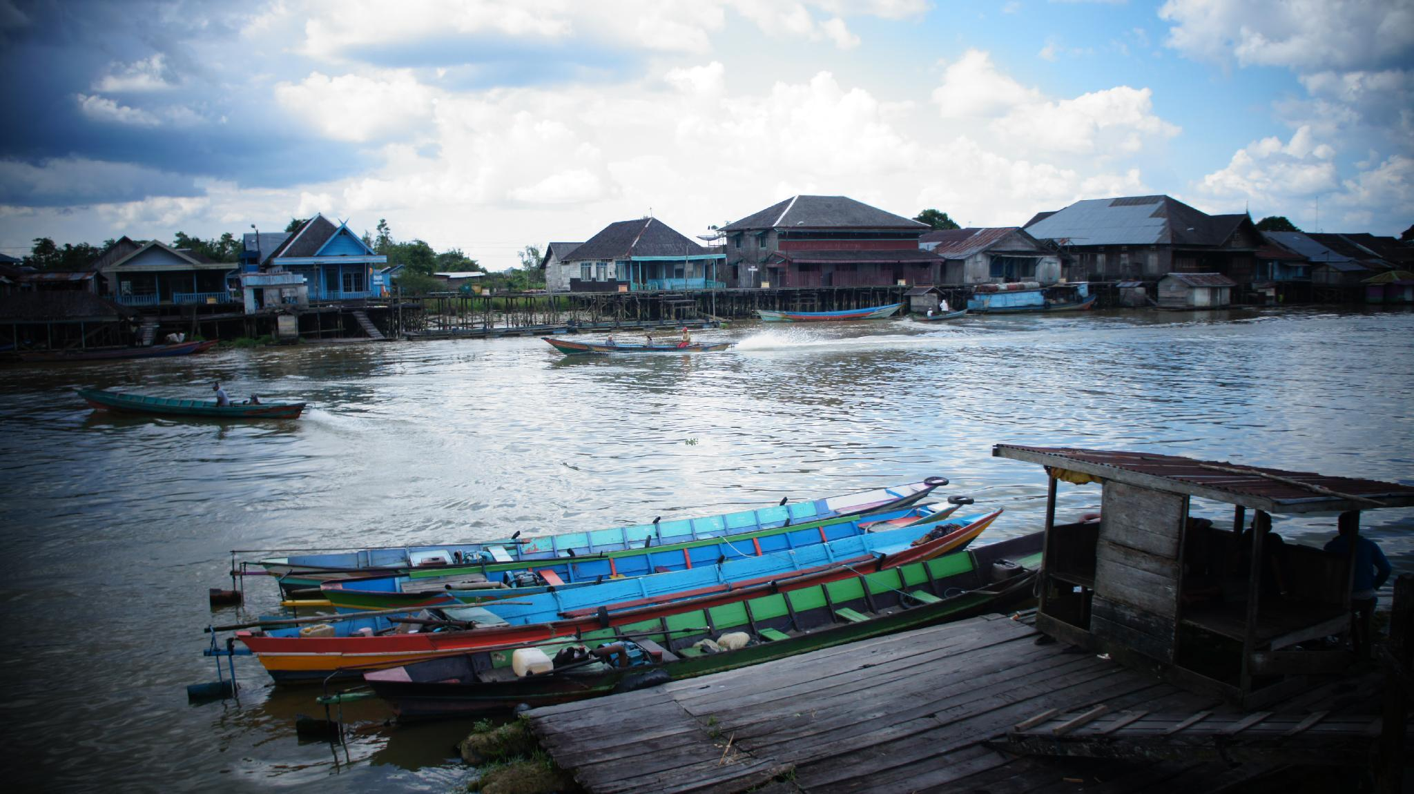 Dayak Traditional Wooden House Riverside